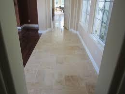 brushed chiseled edge ivory travertine tile flooring with a