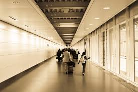 people walking in the hallway inside the building free stock photo