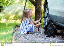 Beautiful Outdoors by Adorable Little Changing A Car Wheel Outdoors On Beautiful