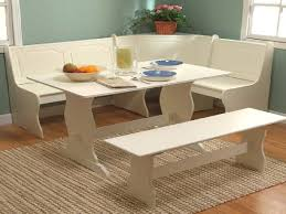 cute white kitchen dining room and wood corner breakfast nook