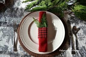 christmas table with red and black calypso in the country