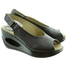 fly london hatt wedge sandals in black in black