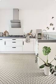 kitchen with ceramic tile effect cushion vinyl flooring