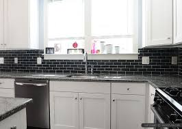 New Caledonia Granite Countertop White Kitchen Cabinets With Black - Black and white kitchen backsplash