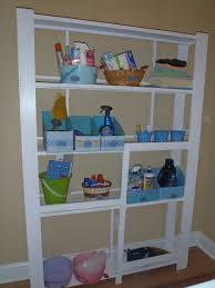 white shelving for laundry room design of awesome laundry room