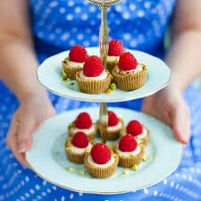 teeny white chocolate pistachio and raspberry tarts woman and home