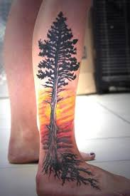 awesome sunset and pine tree tattoo with roots