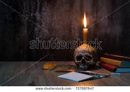 light bulb vintage horror flicker skull a vintage light bulb halloween image burning candle on ancient stock photo 61648066