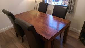 mango wood dining table dark mango wood next dakota dining table and 4 chairs in sutton