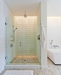 glass tile shower bathroom modern with bathmat bathtub