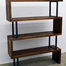 custom made walnut wood and steel ribbon bookshelf by fabitecture