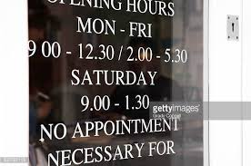 opening hours sign stock photos and pictures getty images