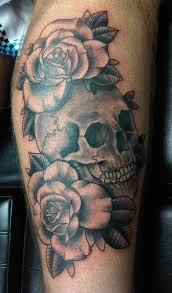 cracked skull and red rose tattoos on thigh in 2017 real photo