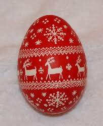 pysanky goose egg ornament and white reindeer and