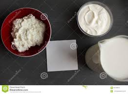 Lactose Intolerance Cottage Cheese by Jug And Glass Cup With Milk And Sour Cream On The Wooden Table