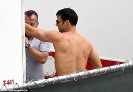 ricky martin hides tattoos on set of american crime story daily