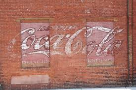 painted mural advertising on red brick wall keene new hampshir editorial stock photo