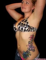 amazing colored flowers side rib tattoo for women tattoo viewer com