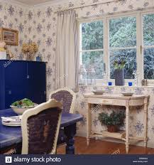 white painted console table below window in country dining room