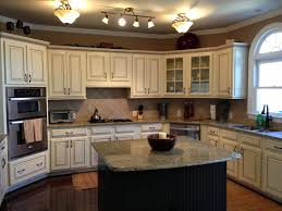Painted And Glazed Kitchen Cabinets by Painted Maple Cabinets Antique White Almond Added Light Rail At