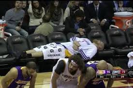 basketball player on bench total pro sports lakers get down to just four eligible players