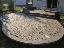paver patio ideas with longue chair also a black square table