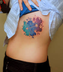i like this negative space water color arrow tattoo tattoos
