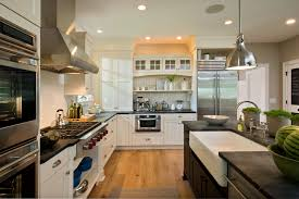kitchen with black island and white cabinets kitchen with antique white cabinets and black island with
