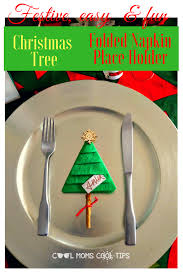 a party hosting table decor idea christmas tree folded napkin