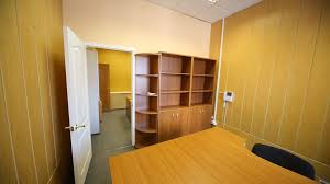 office rooms two small office rooms with empty workplaces and cabinets stock