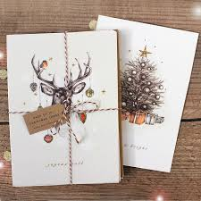pack of reindeer and tree christmas cards by stephanie davies