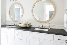 bathroom lighting over round mirror interiordesignew com