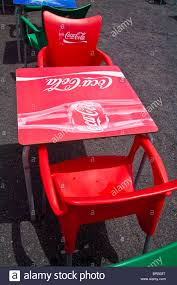 Coca Cola Chairs Bright Red Plastic Coca Cola Logo Table And Chairs At Restaurant