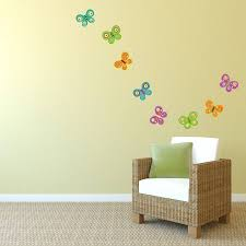 cute butterfly wall stickers in yellow wall painting beautify
