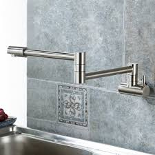 puriscal double joint wall mounted stainless steel kitchen sink faucet puriscal is an interesting kitchen faucet with a double joint design and a fully rotatable spout so you can have the water stream exactly where you mostly