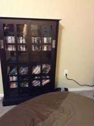 dvd cabinets with glass doors atlantic windowpane 576 cd or 192 dvd blu ray games cabinet with
