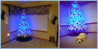 white tree blue lights lights decoration