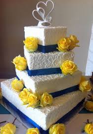 tier white offset rectangular wedding cake with blue bands and
