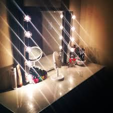 glass top bedroom vanity with mirror and bulb lights of vanity