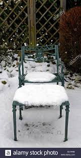 rustic wrought iron garden seat table cover covered with snow