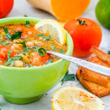 vegan vegetable soup with cherry tomatoes chickpeas and olives gf