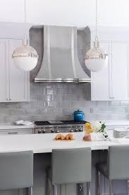 white kitchen cabinets with light grey backsplash stunning kitchen boasts white shaker cabinets paired with