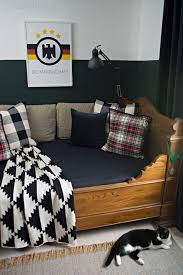 sophisticated boys room with dark green walls cuckoo4design