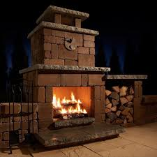 dark compact wood burning outdoor fireplace with stone