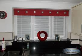 perfect fit venetian blinds and a red roller blind in kitchen