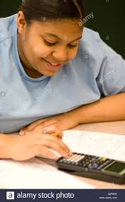 after school study student using a calculator after school study program st paul