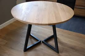 extendable round table modern design steel and timber by
