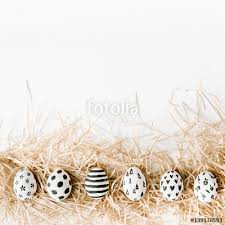fancy easter eggs fancy easter eggs in nest on white background flat lay top view