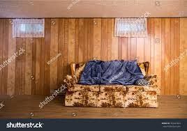 old couch 70s basement blue blanket stock photo 783447823