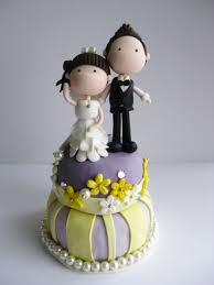 edible wedding cake decorations wedding clay cake topper standing on top of a cake not edible